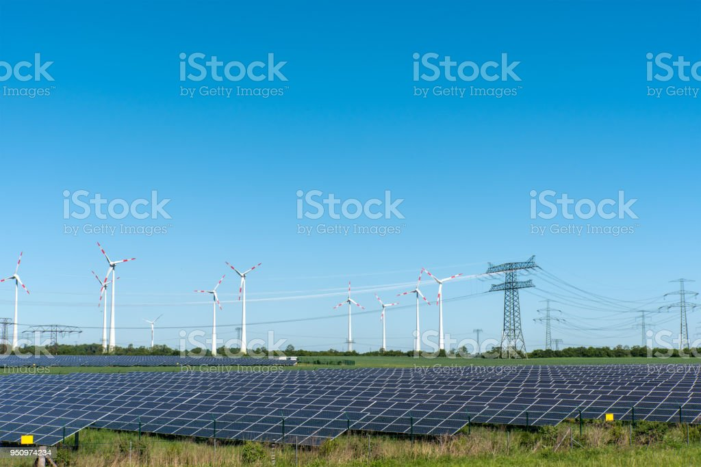Renewable energy plants and power supply lines stock photo