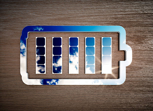 Renewable energy storage sign on dark wooden desk. stock photo