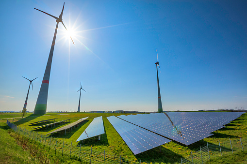 istock renewable energy: wind turbines and modern solar panels (HDRi) 962700664