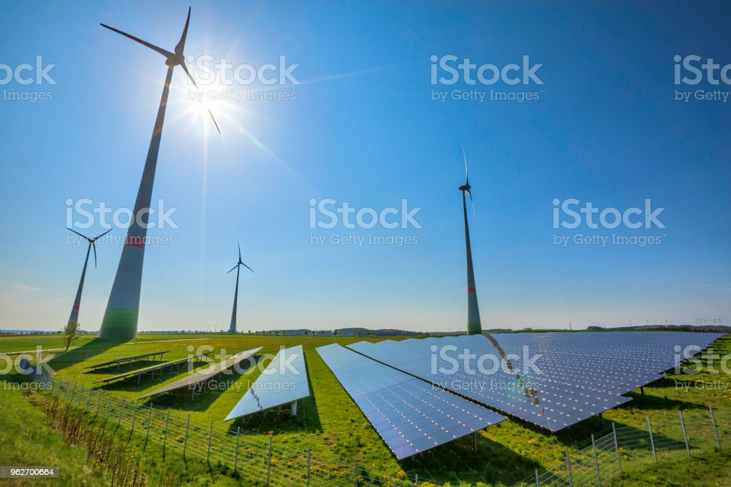 renewable energy: wind turbines and modern solar panels (HDRi) stock photo