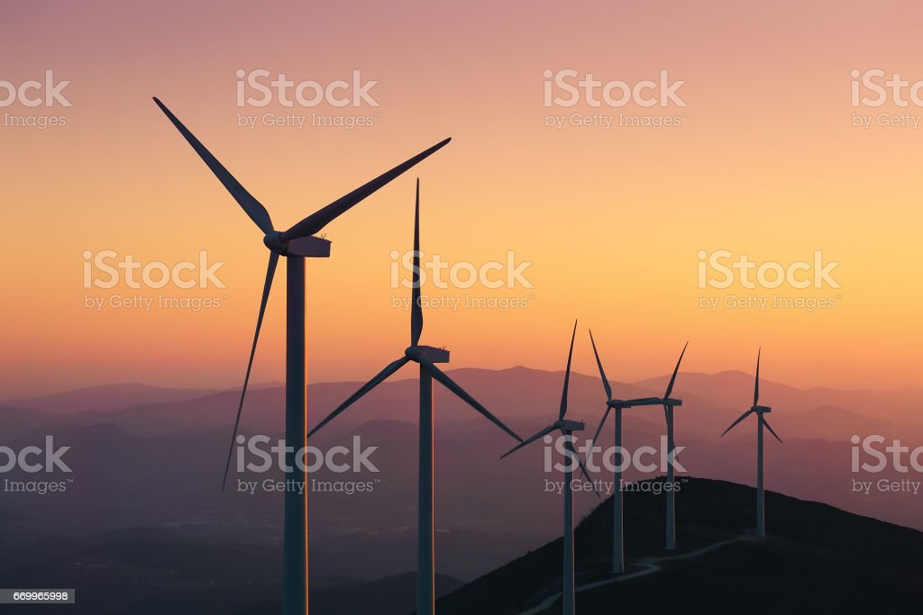 renewable energy with wind turbines stock photo