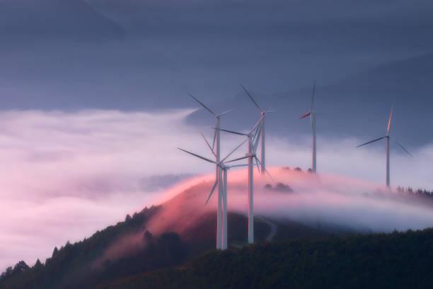 renewable energy with wind turbines stock photo