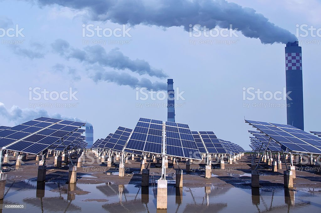renewable solar energy and Coal-fired power plants. stock photo