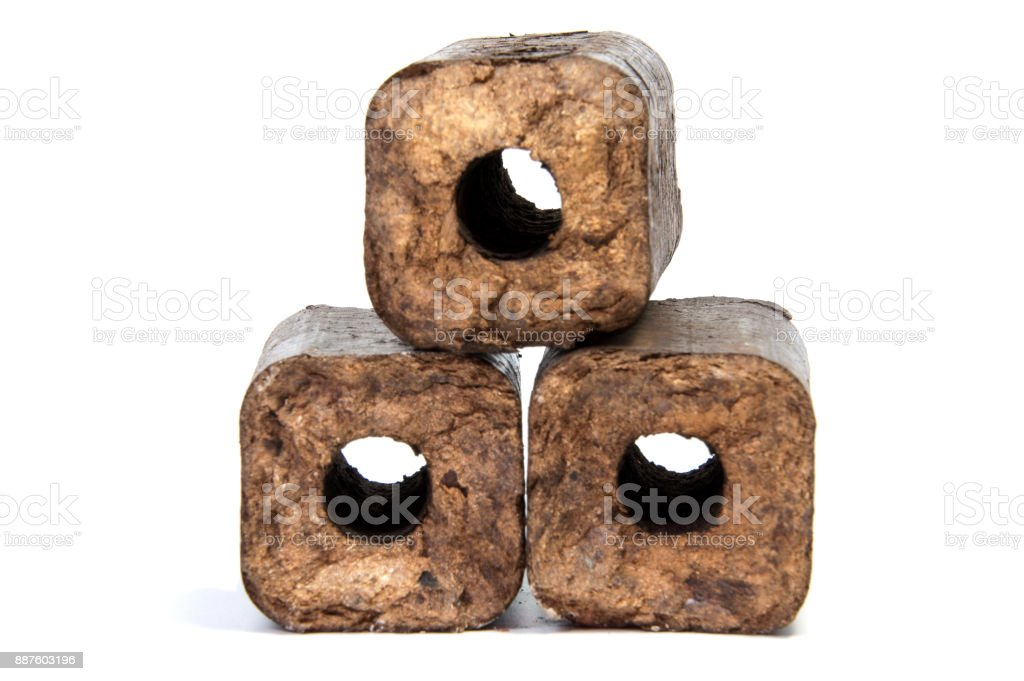 Renewable wooden briquettes for heating Alternative fuel eco fuel bio fuel. stock photo