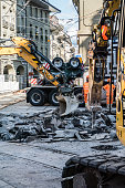 Berne, Switzerland - September 23, 2019 : Replacement of the tram tracks in the old town of Bern, construction site with excavator and construction workers, Switzerland