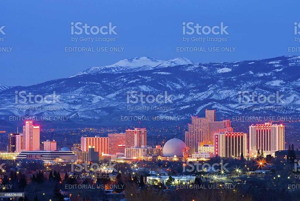 Reno at night Reno, USA - February 2, 2013: Reno, known as The Biggest Little City in the World, is famous for it's casinos, and is the birthplace of the gaming corporation Harrah's Entertainment. Architecture Stock Photo