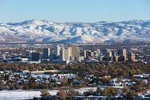 reno, nevada downtown during winter - skyline mountains usa stock photos and pictures