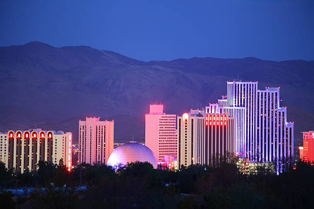 Reno Reno Nevada downtown skyline glittering at night. Reno is a city in the US state of Nevada near Lake Tahoe. Known as