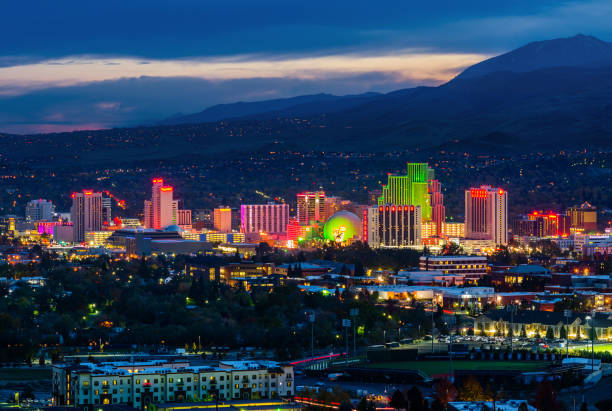 Reno skyline at night RENO - OCTOBER 30, 2014: Reno skyline on October 30, 2014. It's known as The Biggest Little City in the World, famous for casinos and the birthplace of the gaming Harrah's Entertainment. nevada stock pictures, royalty-free photos & images