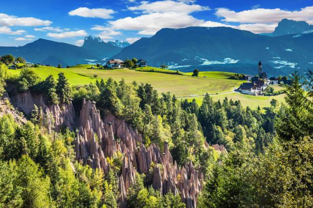 renon's earth pillars - плато стоковые фото и изображения