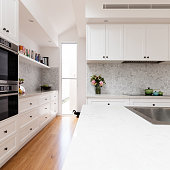 Renovated classic contemporary style kitchen in white and grey tones