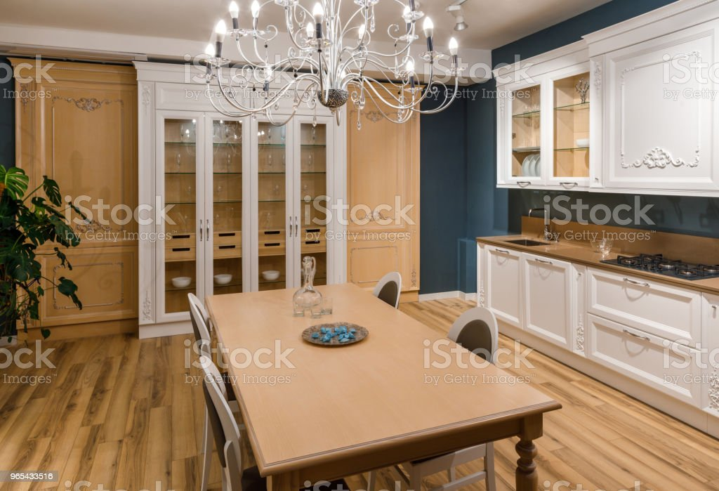 Renovated kitchen interior with chandelier over table zbiór zdjęć royalty-free