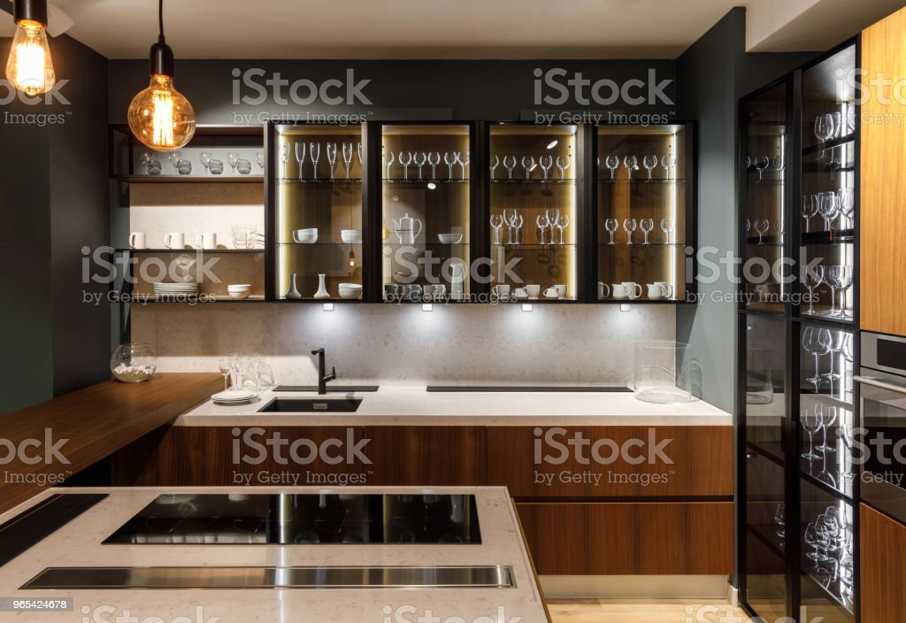 Renovated kitchen interior with glasses in cupboard royalty-free stock photo