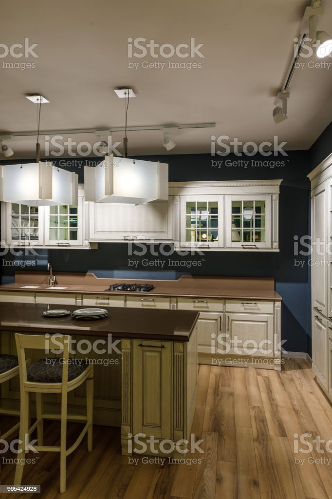 Renovated kitchen interior with lamps over counter royalty-free stock photo