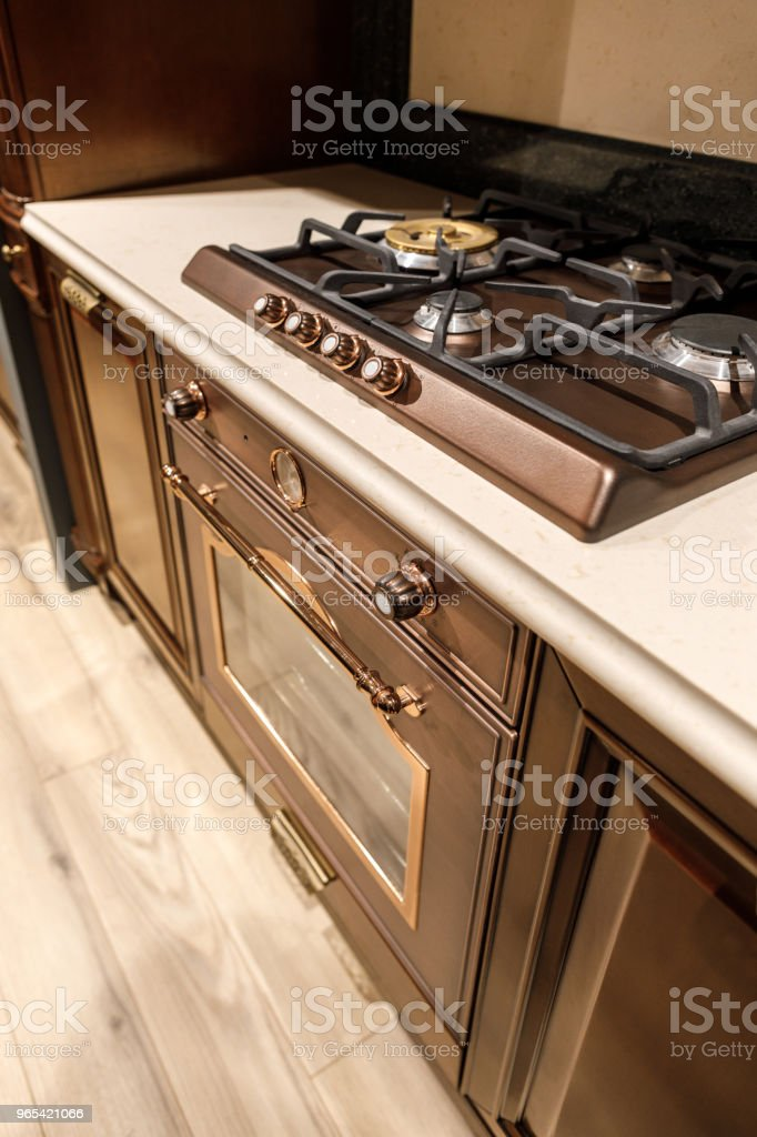 Renovated kitchen interior with stove on counter royalty-free stock photo