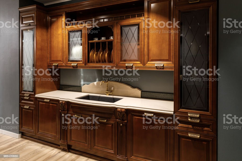 Renovated kitchen interior with wooden cabinets and sink zbiór zdjęć royalty-free