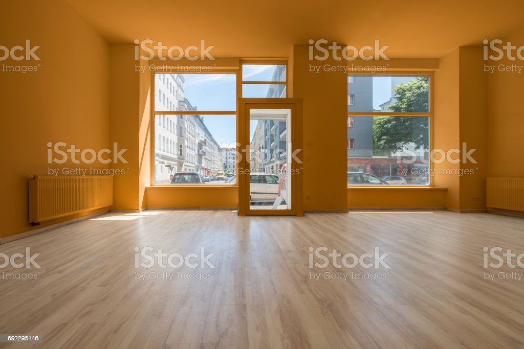 renovated store / shop - empty room with wooden floor and shopping window stock photo