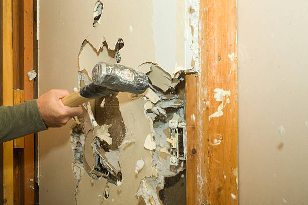 Renovating Wall, Removing Drywall with a Sledgehammer A sledge hammer is a great tool for removing unwanted drywall. demolishing stock pictures, royalty-free photos & images