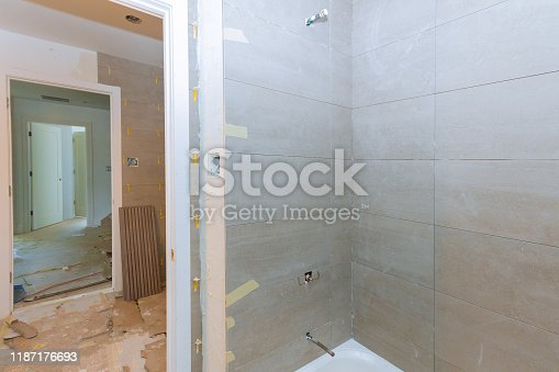 1138442636 istock photo Renovation construction laying floor and wall tile reconstruction of bathroom 1187176693