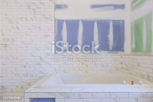 1138442636 istock photo Renovation construction laying floor and wall tile reconstruction of bathroom 1217013187