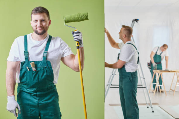 renovation crew keeping a roller - painter stock photos and pictures
