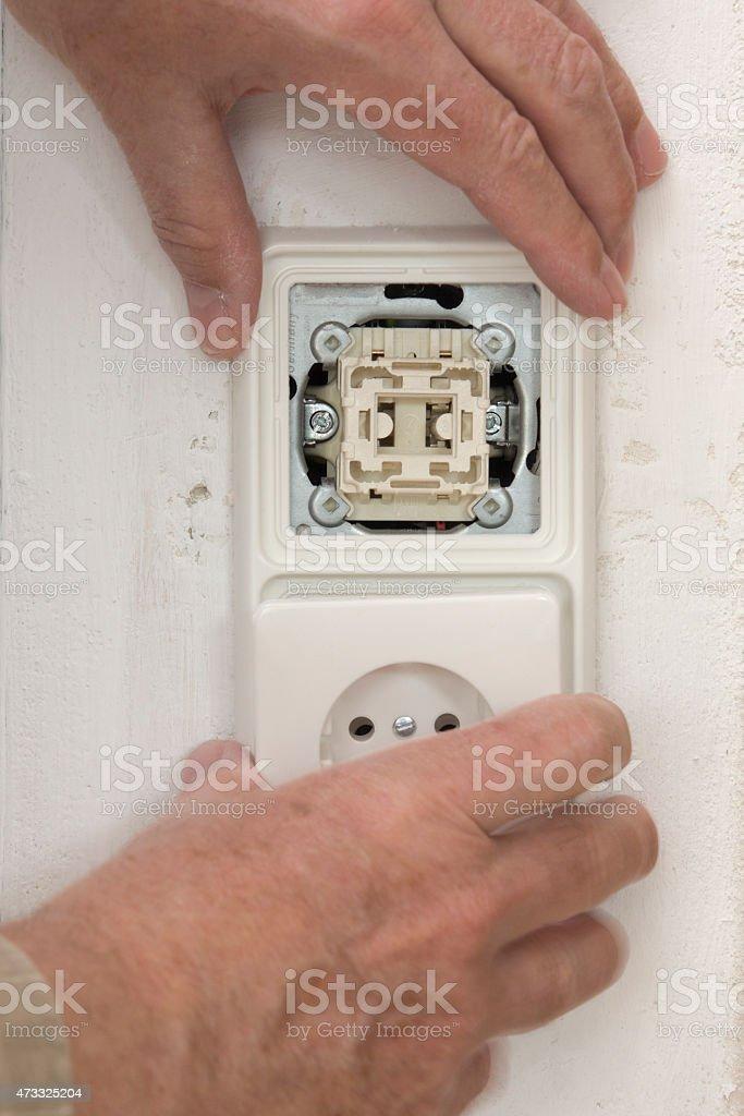 Renovation Light Switch And Plug Socket On Wall Hand Stock