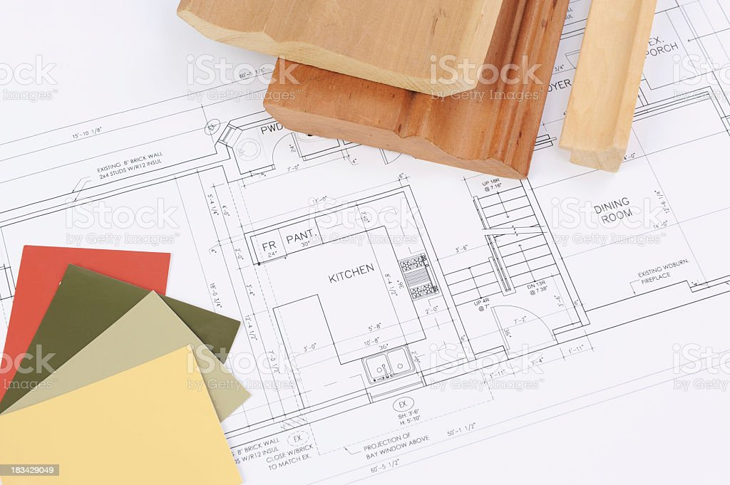 Renovation plans for kitchen with wood and paint samples stock photo