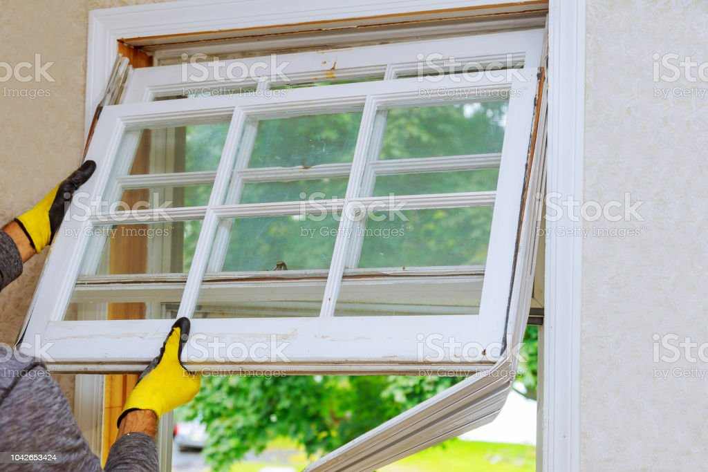 renovation work in an old house and replacing windows stock photo