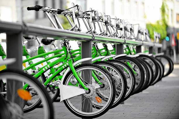 Rent a green bicycle stock photo