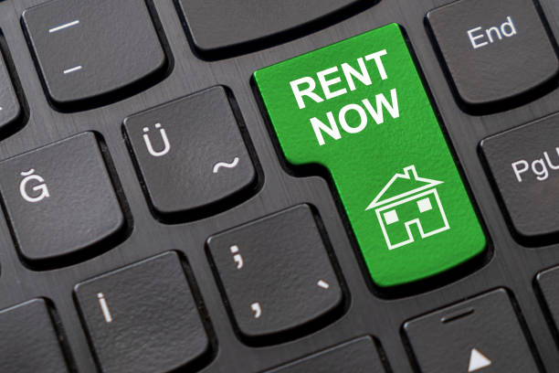 Rent a house now key on the black computer keyboard stock photo