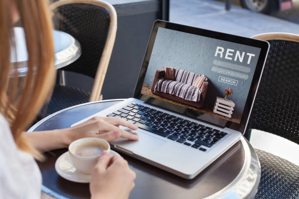 rent a room, flat, apartment, house online - concept rent online concept, woman using internet website for rental apartments, houses and flats house rental stock pictures, royalty-free photos & images