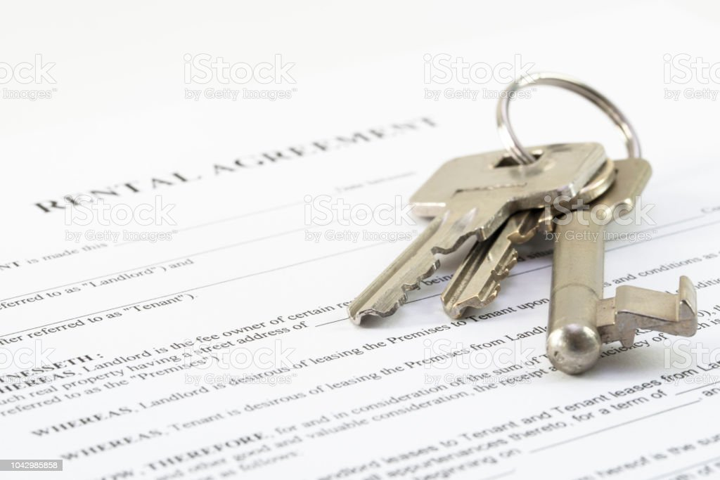 rental agreement document with a set of house keys, selected...
