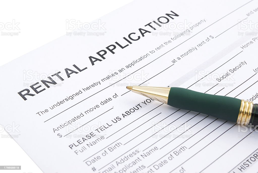 rental agreement form and a pen close up stock photo