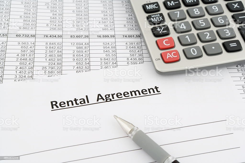 rental agreement with numbers, calculator and pen stock photo