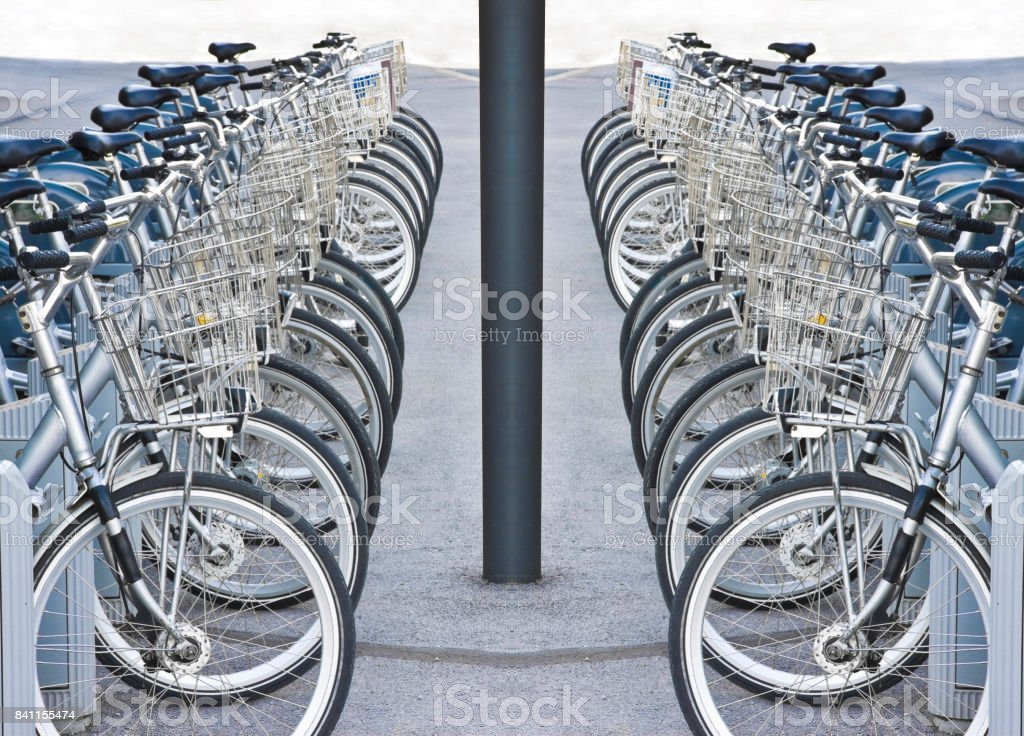 Rental bicycles parked on a street stock photo