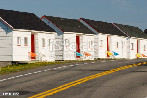 Seaside cottages are all lined up on the roadside awaiting customers