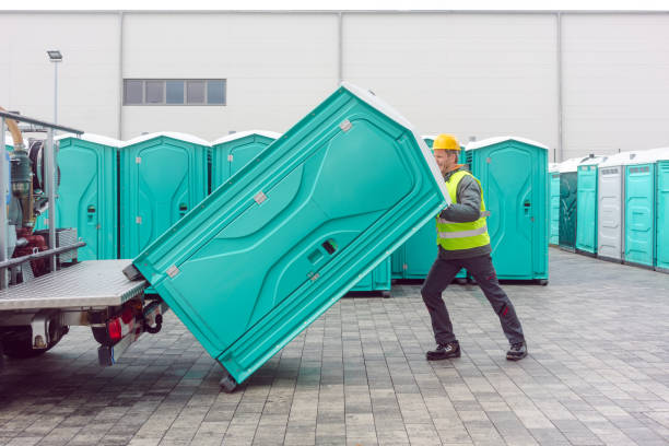 Rental lavatory being loaded on truck Rental lavatory being loaded on truck by worker portable toilet stock pictures, royalty-free photos & images