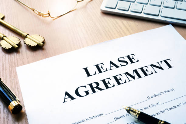 rental lease agreement form on an office desk. - tenant stock photos and pictures