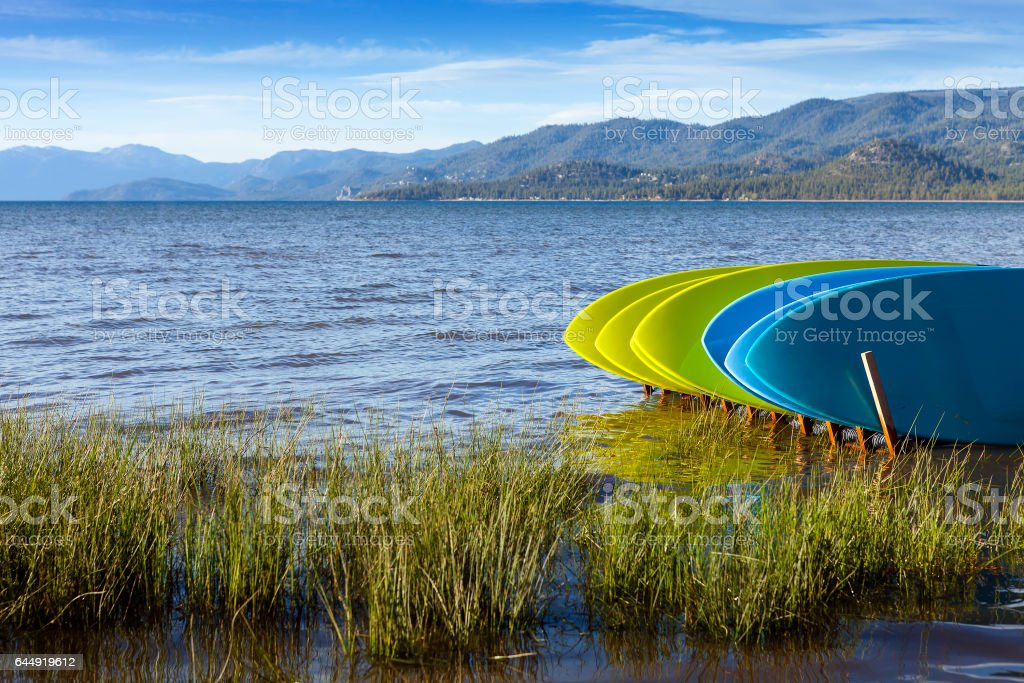 Rental Stand Up Paddle boards on shore of Lake Tahoe, California. stock photo