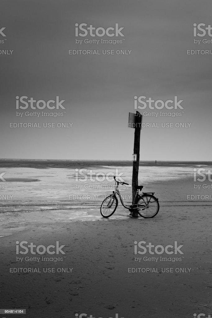 Rented bike on beach of Northsea island Borkum in winter stock photo