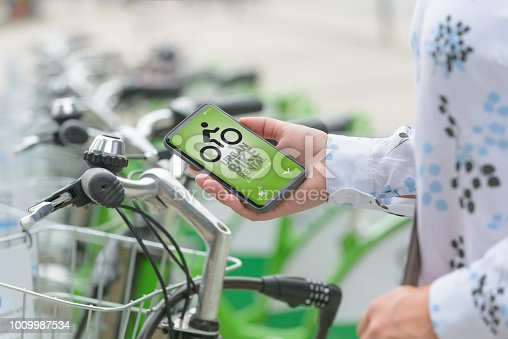 istock Renting bicycle from urban bicycle sharing station 1009987534