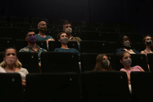 Reopening Cinema - Visitors In Movie Theater stock photo