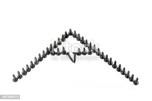 istock Repair as conquest of a mountain peak . mountin with snow cap drawing by black screws on white background 697998310