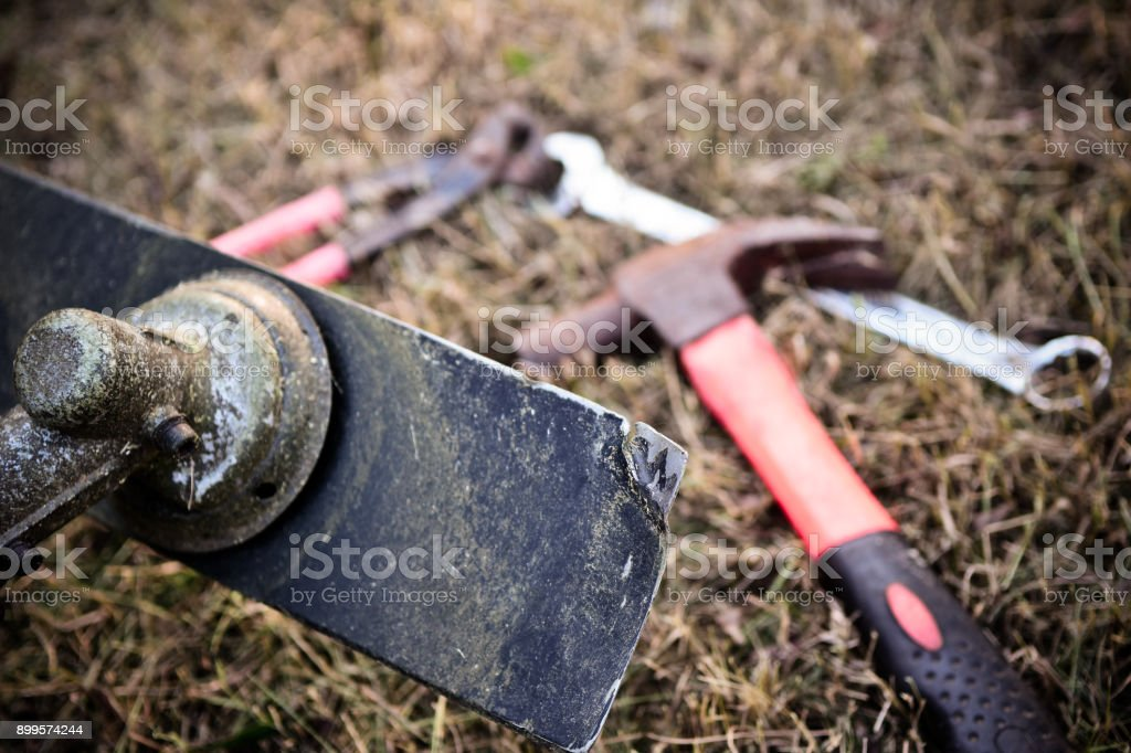 Repair blade of a lawn mower stock photo