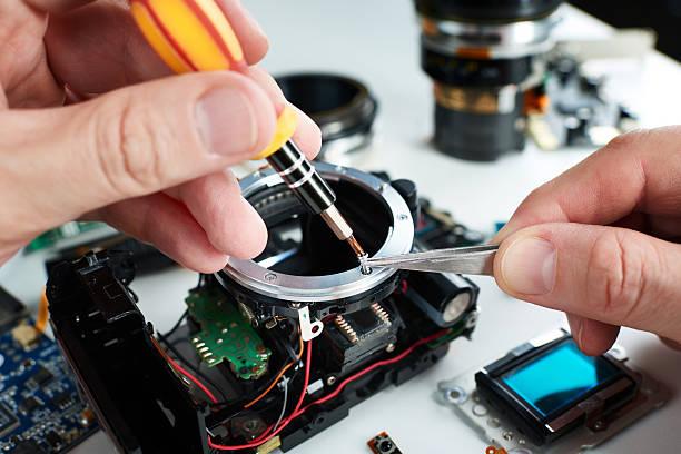 Repair broken DSLR camera in service center stock photo