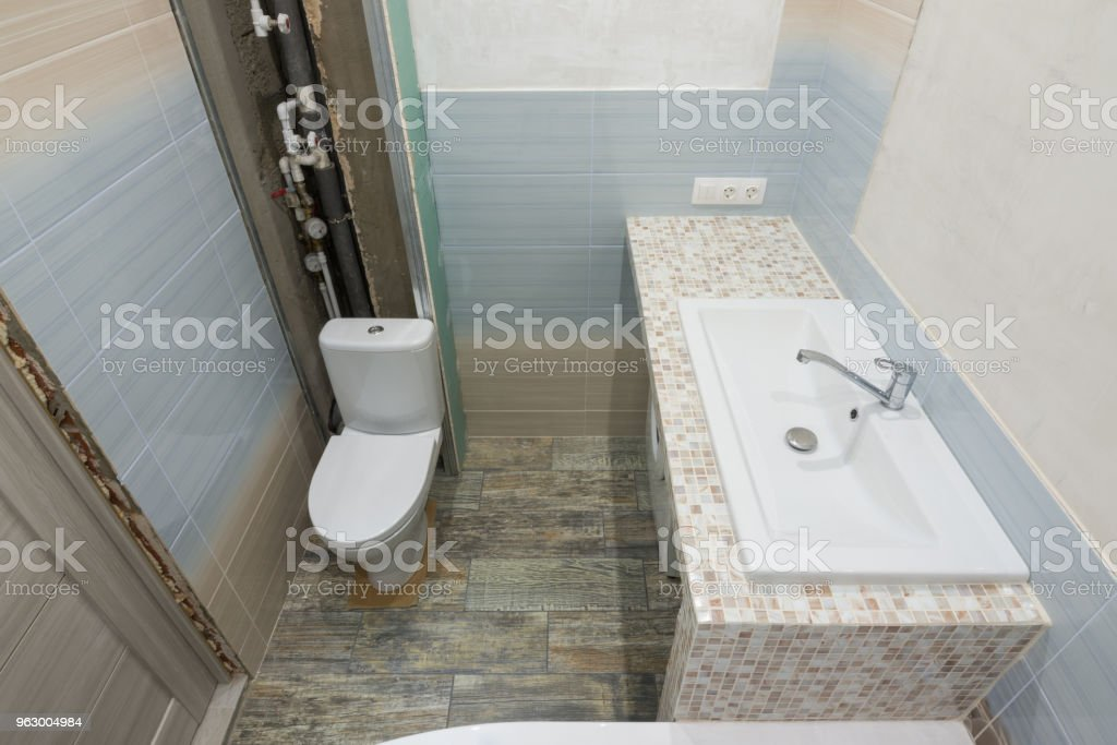 Repair in the bathroom, top view of the toilet and washbasin