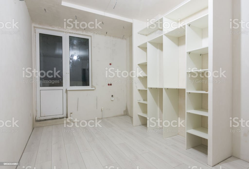 Repair in the living room of new buildings, built-in wardrobe and on the floor laminated panels stock photo