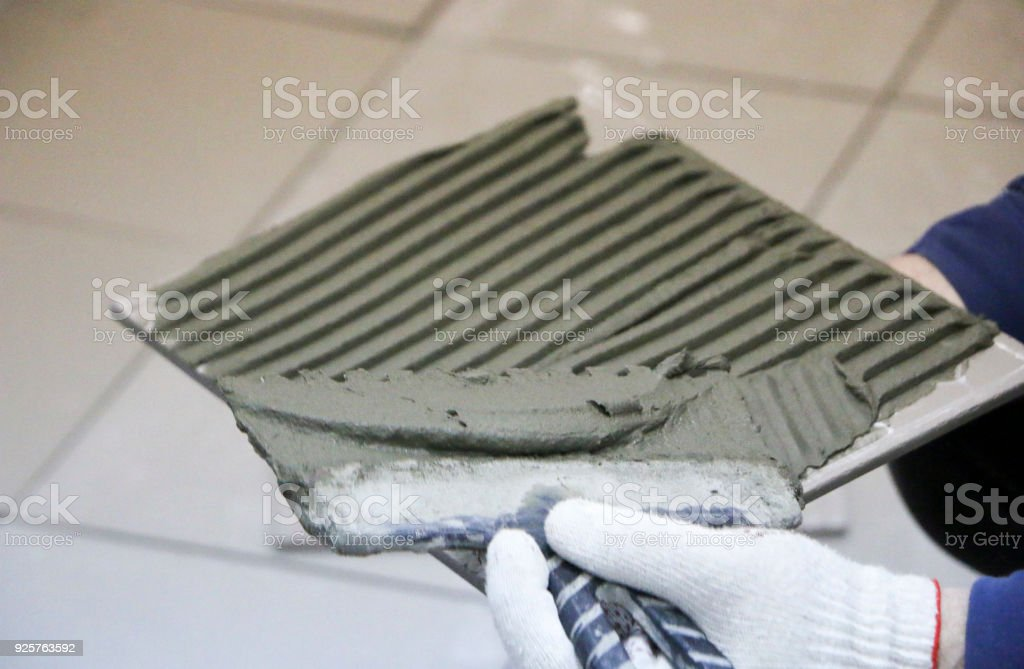 Repair Interior Decoration Laying Of Floor Ceramic Tiles Mens Hands