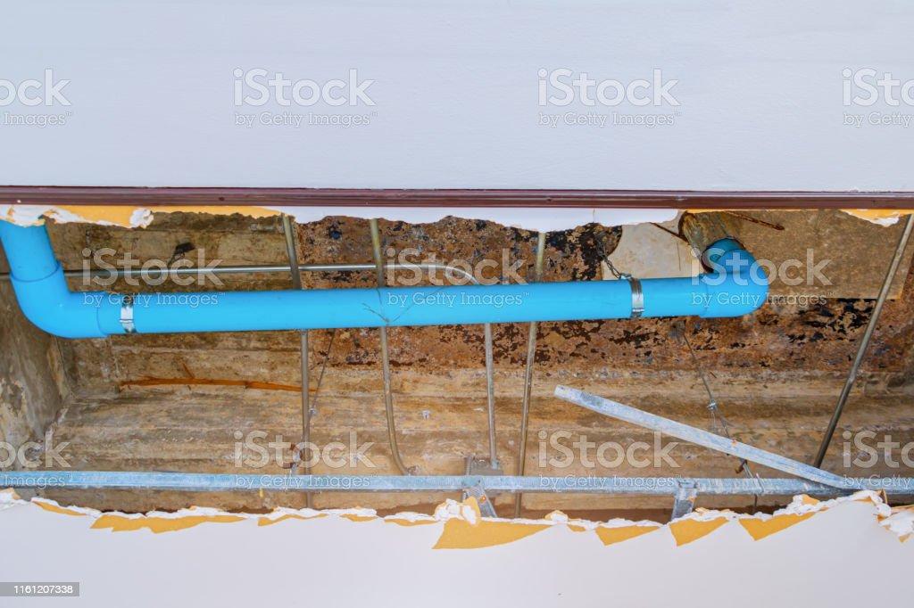 repair leak water pipe in under gypsum ceiling interior office...
