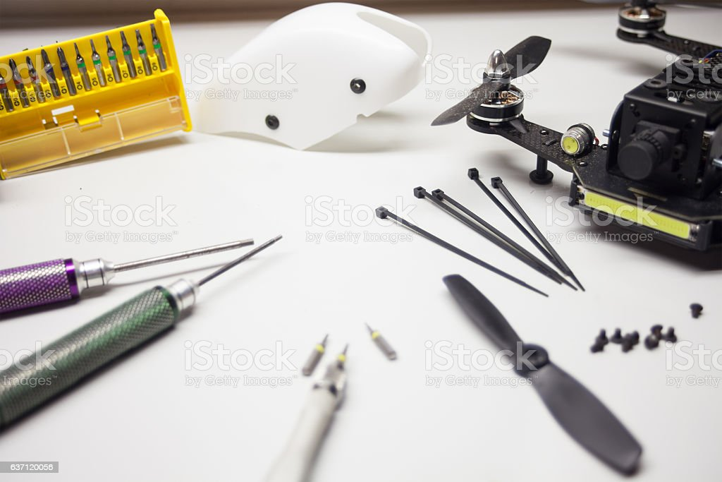 Repair maintenance drone, screws, screwdriver, tools stock photo